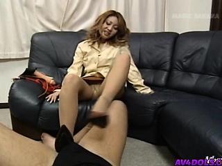 Yuuko puts feet round shoes..
